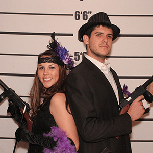 New Jersey Murder Mystery party guests pose for mugshots